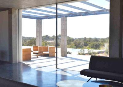 industrial and modern living room and patio in villa luz in cap de barbaria in formentera