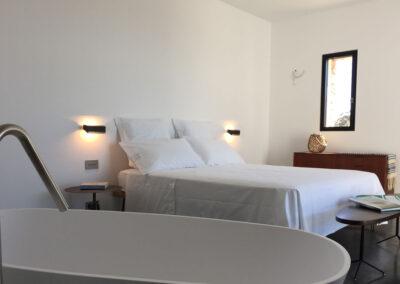 stunning second bedroom with bathtub in villa luz in cap de barbaria in formentera