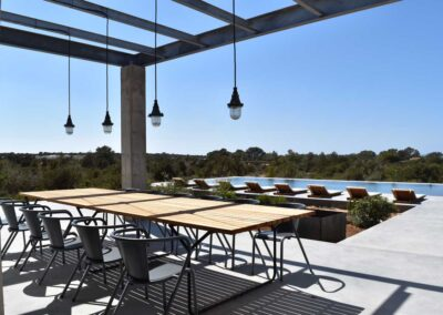 stunning view of dining table and swimming pool from the terrace of the luxury villa luz in cap de barbaria in formentera