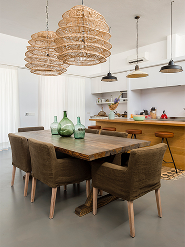 refined dining table with handmade ceiling lamp in formentera