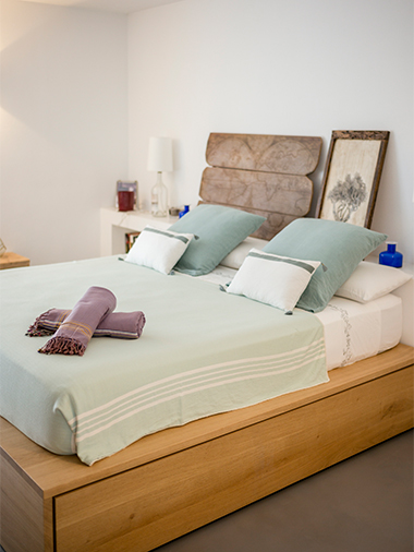 radiant wood bed with furniture in formentera