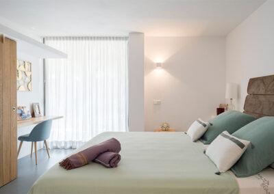 deluxe bedroom with desk in villa ines