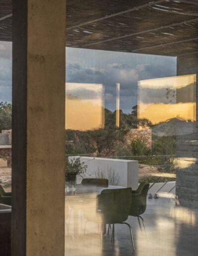 window reflection of the grand hallway of villa luz in cap de barbaria in formentera