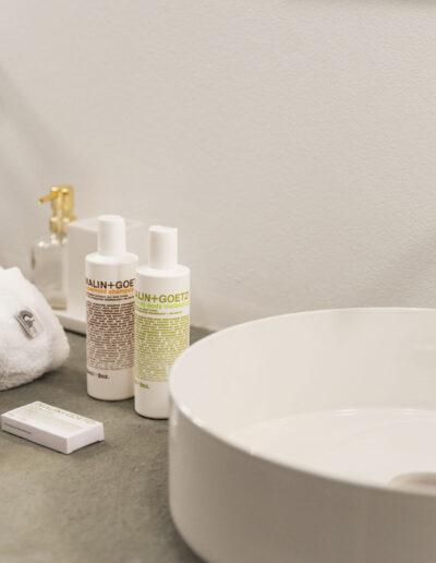 fifth bathroom details with Malin + Goetz soap in villa luz in formentera