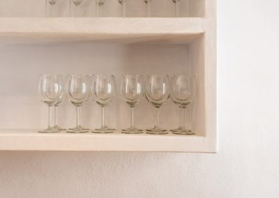 pretty shelves with wine glasses