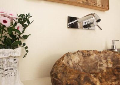 flower and sink detail in first toilet of villa sueño in formentera
