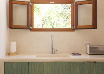 sink and window in the kitchen of villa sueño in formentera