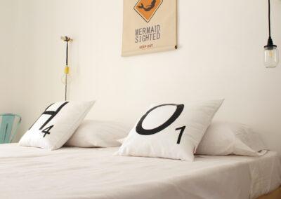 beautiful bedding in second bedroom of villa sueño in formentera