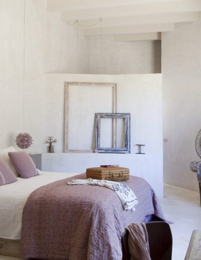 super double bedroom in pink and handmade chairs in villa bohemian formentera