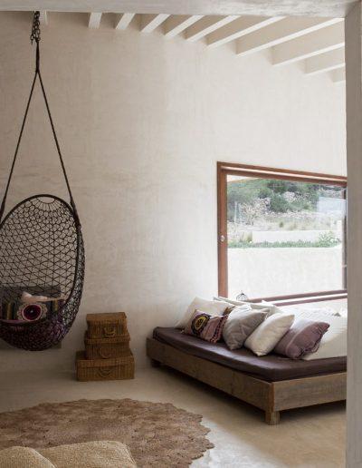 deluxe master bedroom with hang chair in villa bohemian