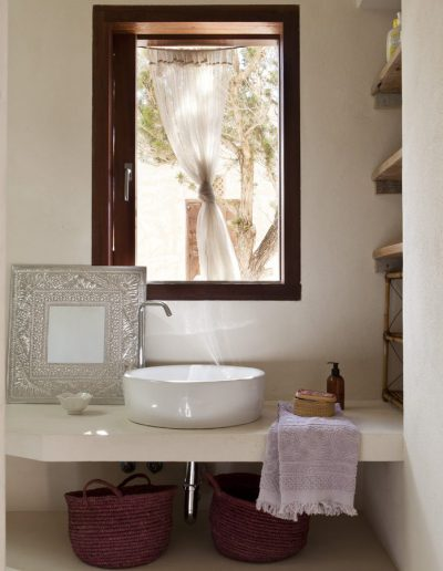 luscious bathroom with a window over the sink in villa bohemian