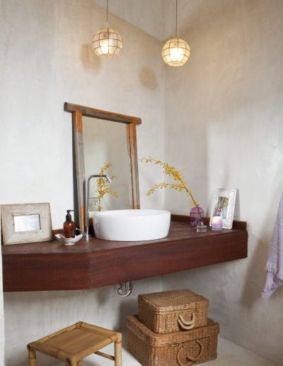 modern bathroom with wood with concrete walls at villa bohemian