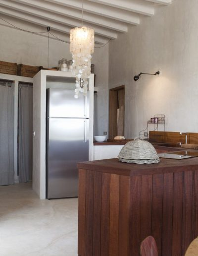 radiant kitchen with silver fridge at villa bohemian