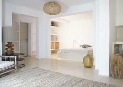 deluxe double bedroom with wood chair in villa Om