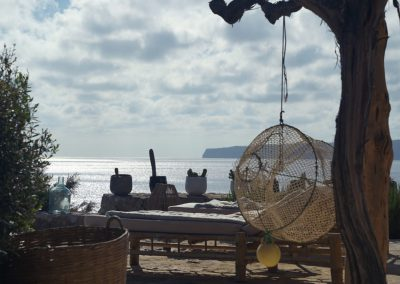 stunning sea view from the balcony with hanging chairs