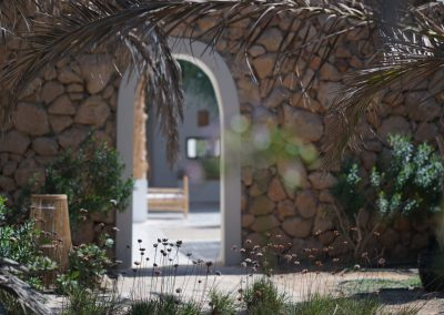 excellent passage through a arch with a stone walls