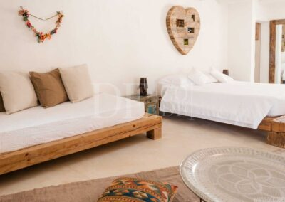 double bedroom and additional sleeping area in villa casanita, formentera