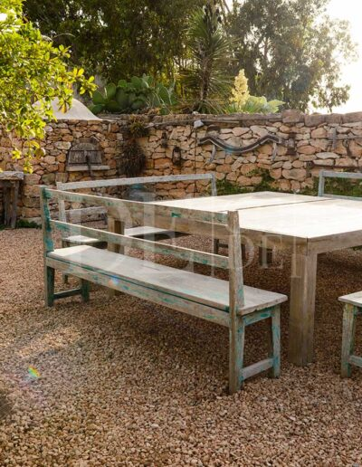 seating area made of wood, for relaxing lunch or dinners in villa casanita, in sant francesc area in formentera