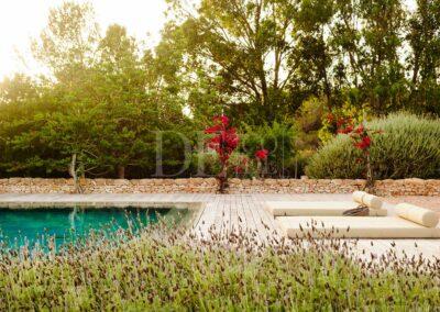 sun setting over the garden of luxury villa casanita for rent in formentera island