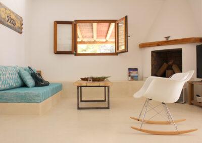relax area with fireplace and sofa in villa sueño in la mola formentera