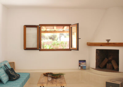 charming window by the fireplace in villa sueño formentera