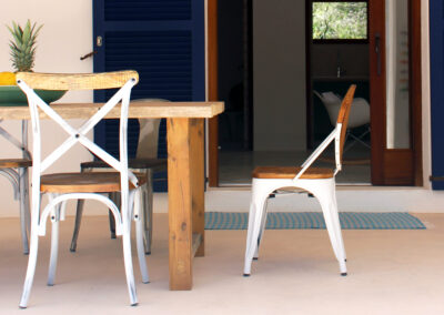 wooden dining table on the terrace of the lovely villa sueño in la mola formentera
