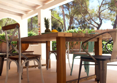 dining table and chairs on the relaxing porch of villa sueño in la mola formentera