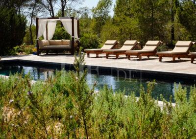 swimming pool among the garden's nature of villa Barbara, luxury summer rental in formentera
