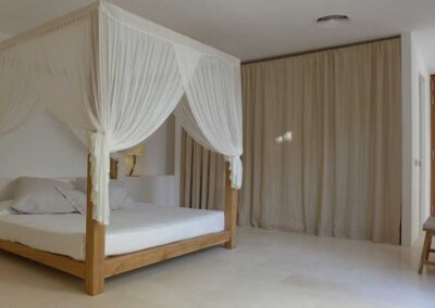 deluxe bedroom with white curtains in villa es vedra