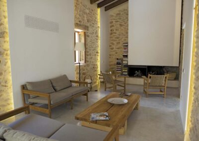 stunning livingroom with sofas and coffe table near fireplace at villa es vedra