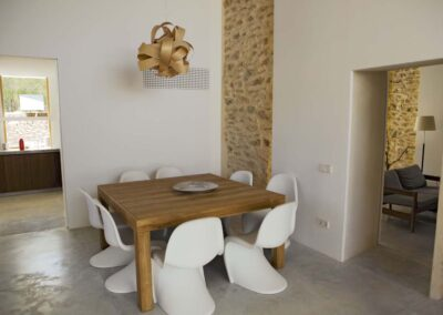 refined dining table with handmade ceiling lamp in villa es vedra