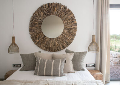 bedding and details of this stunning bedroom in villa Soleil for rent in la mola, formentera