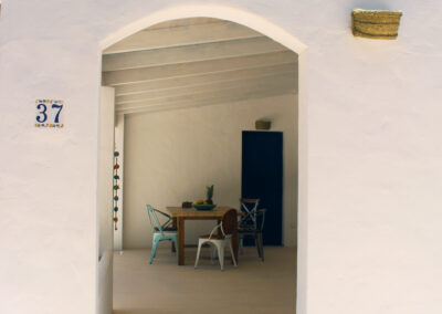 patio with dining table viewed from garden in nice villa sueño in formentera